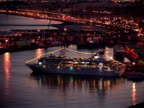 Ship in harbor and zoom back to town at twilight video