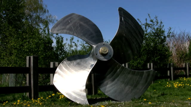 Ship Propeller On The Grass Near A Harbor (HD 1080p30) video