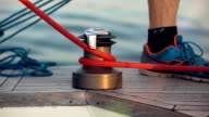 Ships boy knotting  rope on a boat video