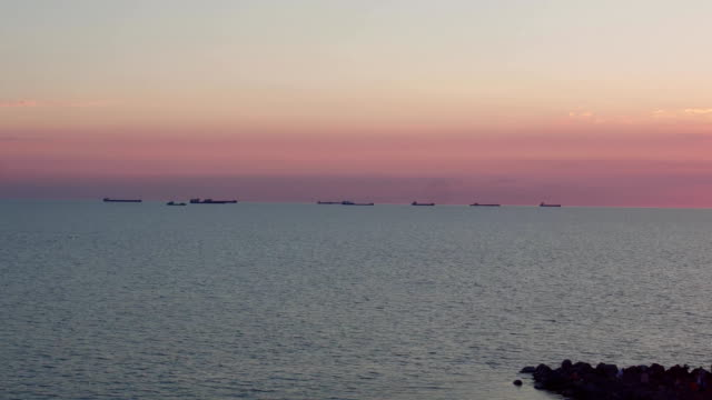 ships in the sea at sunset, aerial shot video
