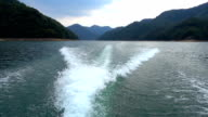 ship's wake or water trail in the lake video