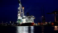 Shipyard with big container ship, time lapse video