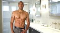 Shirtless muscular man posing video
