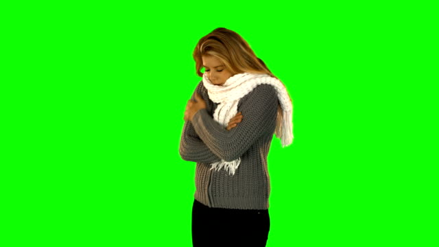 Shivering pretty woman with winter clothes video
