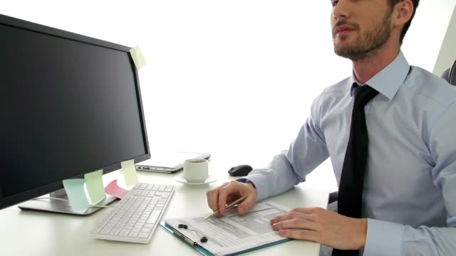 Shocked businessman looking at document video