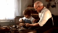 HD DOLLY: Shoemaker Teaching Young Apprentice video