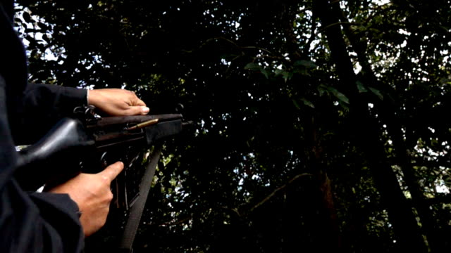 Shooting a rifle,Slow motion video