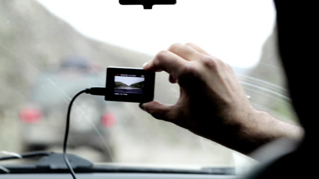 Shooting from car interior as SUV going ahead at cloudy day. video