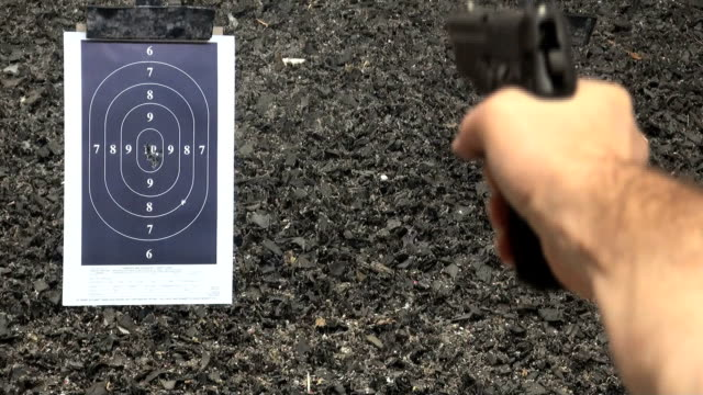 Shooting handgun pistol at target range. video