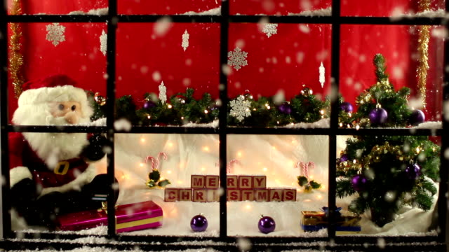 Shop window display at Christmas with snow video