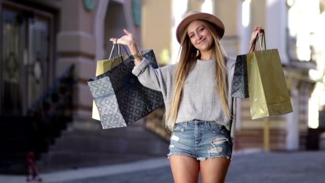 Shopaholic woman holding many shopping bags video