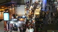 Shopping at night market in Bangkok video