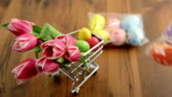 shopping easter decoration like tulips and eggs video