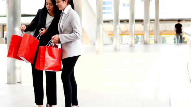 SEA: Shopping : friends walking in city with shopping bags HD format. video