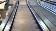 Shopping mall escalator moving down video