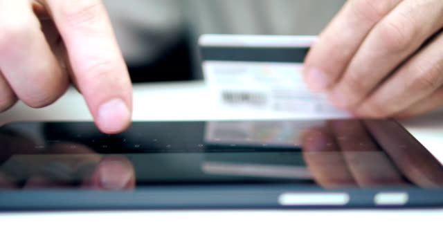 Shopping online with the introduction of the credit card number on the tablet video