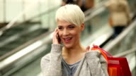 Shopping woman talking on cell phone video