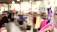 Shopping woman with shirt video