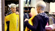 Shopping woman with yellow jacket video