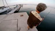 Shore fishing. Sea bass video