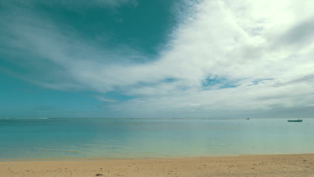 Shore with clear blue water and soft sand video