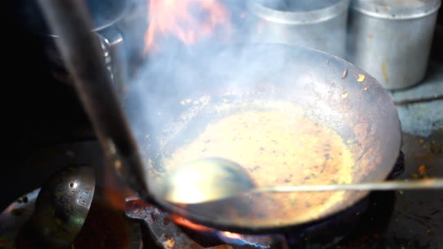 Short film showing preparation of Indian cuisine and people eating video