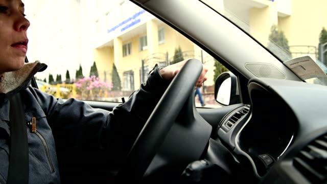 Short hair blond woman driving a car video