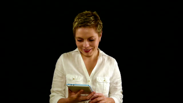 Short hair business woman texting by tablet pad video