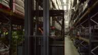 Shot follows forklift through storage warehouse, shot on R3D video