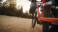 POV shot of a biker's foot pedaling video