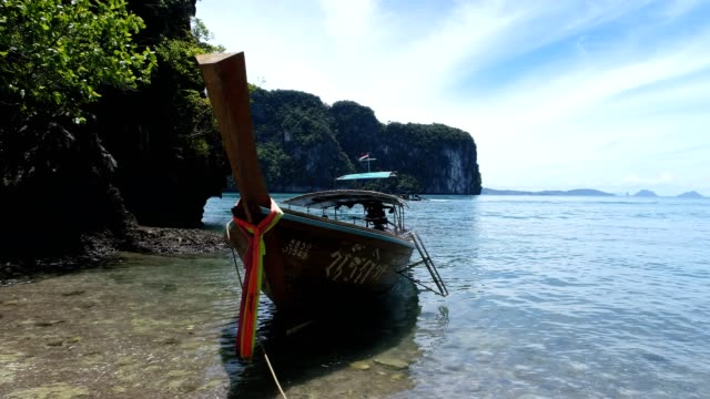 Shot of a longtail boat on a tropical island video