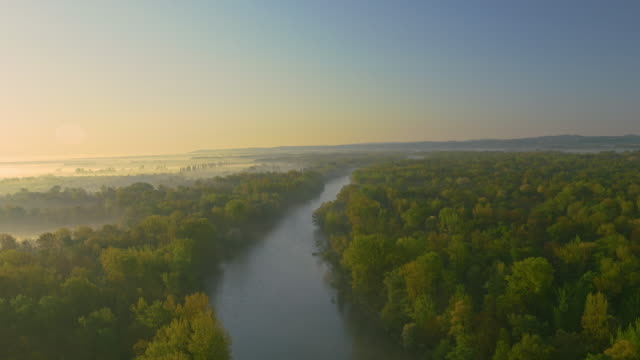 AERIAL shot of a river at dawn video