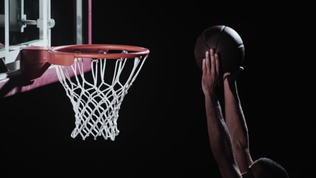 SLO MO shot of basketball player dunking the ball video