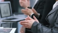 LD shot of business hands applauding in meeting room video