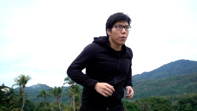 SLO MO MS TS Shot of Man jogging in the morning in Chiang Mai, Thailand video