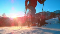 SLO MO LD shot of mountaineer running with snowshoes on video