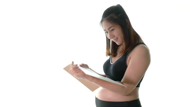 Shot of pregnant woman reading a book video