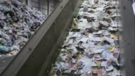 LD shot of the paper on the conveyor belt in a recycling facility video