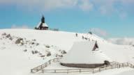 T/L 8K shot of tourists at chapel at Velika Planina video