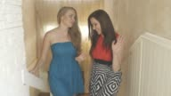 Shot of two beautiful women walking on a stairs in beautiful home. video