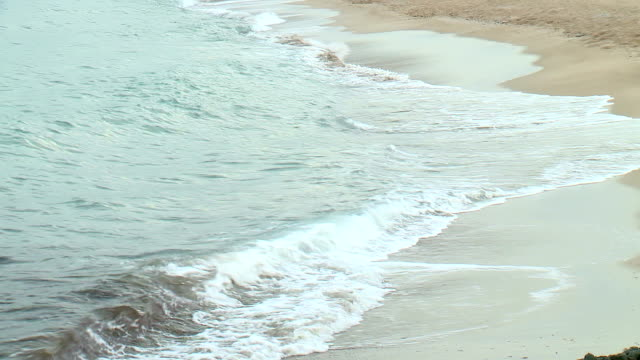 Shot of Waves Rolling Up White Sand Beach video