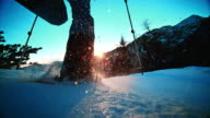 SLO MO LD shot Snowshoeing into sunset on mountain top video