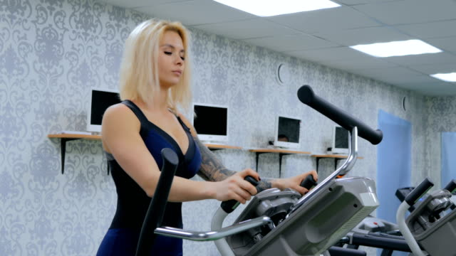 3 shots. Athletic young woman working out on stepper machine at the gym video