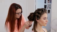 3 shots. Hairdresser finishing hairstyle for young pretty woman video
