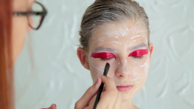 4 shots. Professional make-up creating face makeup art video