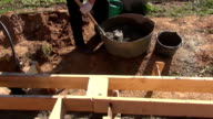 Shoveling concrete into bucket video