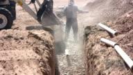 Shoveling Stone in Septic Drain Field video