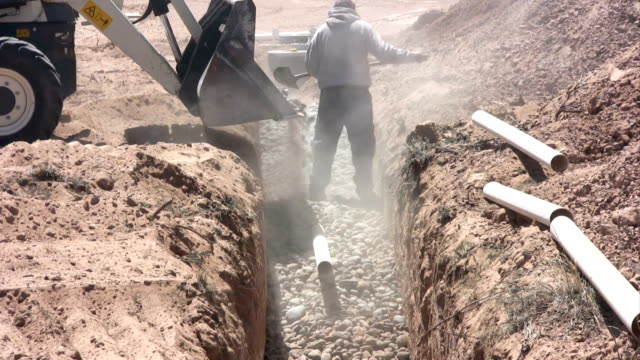 Shoveling Stone in Septic Drain Field video