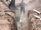 NTSC: Shoveling Stone in Septic Drain Field video