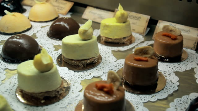 Showcase of cakes, pastry in window display video